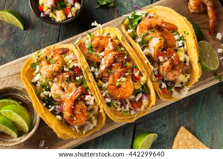 Homemade Spicy Shrimp Tacos with Coleslaw and Salsa - stock photo