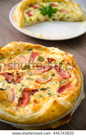 Homemade Spinach and Bacon Egg Quiche in a pie crust. French cuisine