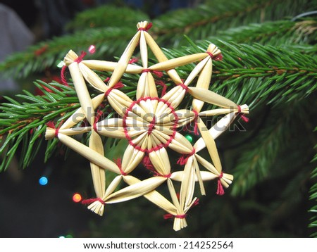 Homemade straw decor on Christmas tree close up - stock photo