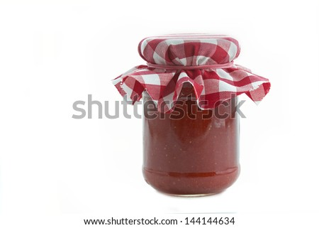 Homemade strawberry jam in a glass on white background