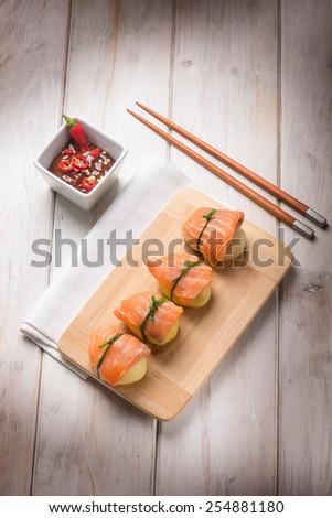 homemade sushi with potatoes and fresh salmon - stock photo