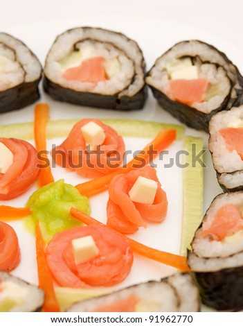 homemade sushi with salmon and sauce