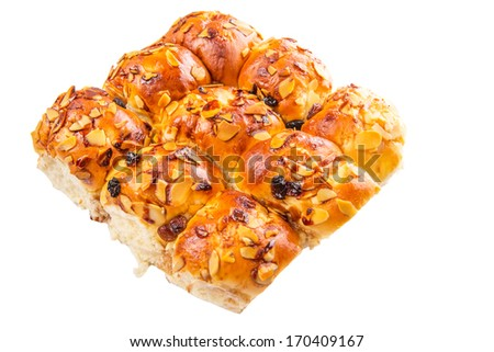 Homemade sweet bun with almond and raisins on a white background