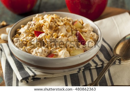 Homemade Sweet Candy Apple Salad with Peanuts and Marshmallows