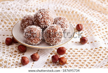 Homemade sweets with crumbs of cookies, coconut and nuts - stock photo