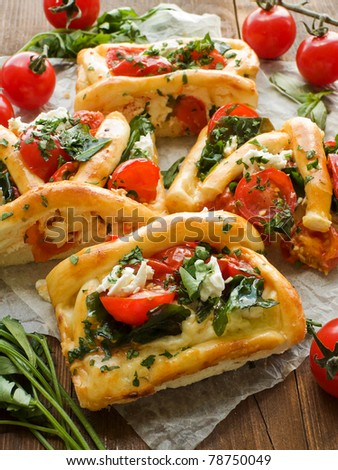 Homemade tart slices with cottage cheese, herbs and cherry tomatoes. Shallow dof. - stock photo