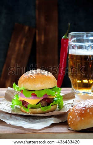 Homemade tasty beef burger with lettuce, ketchup, tomato, onions and ...