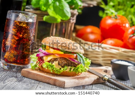 Homemade tasty hamburger and a Coke with ice