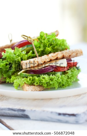 Homemade tasty vegetarian sandwich with fresh vegetables and cheese