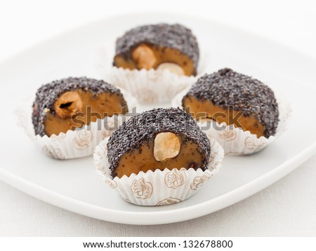 Homemade toffee with hazelnuts and poppy seeds - stock photo