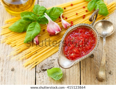 Homemade tomato sauce for pasta and meat from fresh tomatoes with garlic, Basil and spices. Selective focus - stock photo