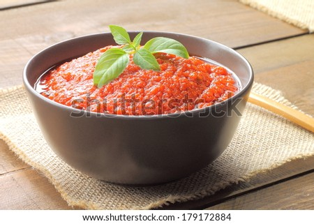 Homemade tomato sauce with basil - stock photo