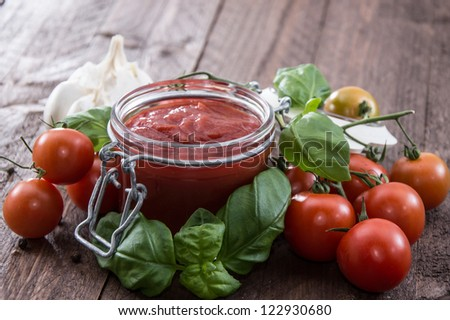 Homemade Tomato Sauce with fresh ingredients - stock photo