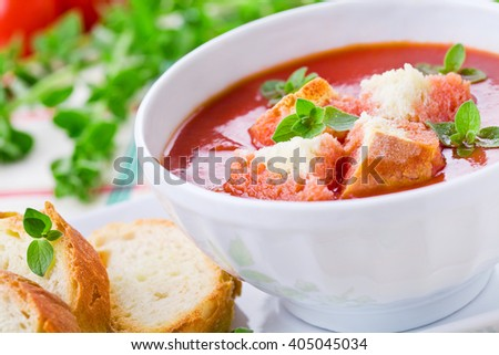 Homemade tomato soup with oregano and croutons - stock photo