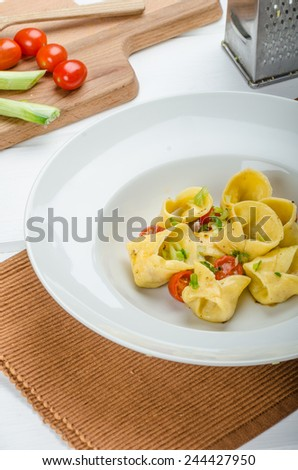 Homemade tortellini from semolina flour, stuffed with Parmesan cheese and tomatoes