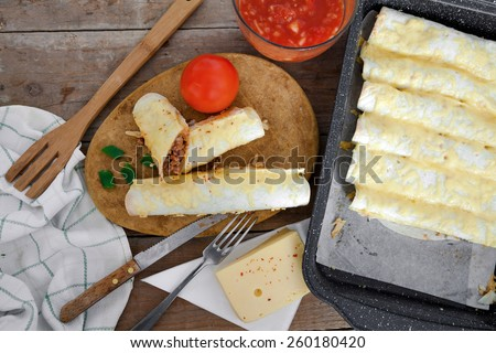 Homemade tortilla with meat and beans - stock photo