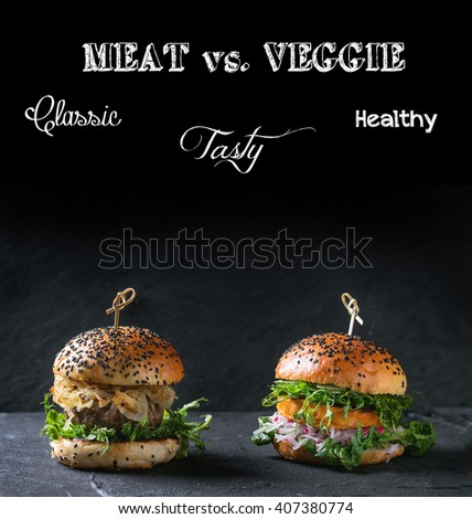 Homemade traditional and veggie burgers with beef, fried onion, sweet potato, radish and pea sprouts, over black textured background. Healthy vs unhealthy concept food with removable sample text - stock photo
