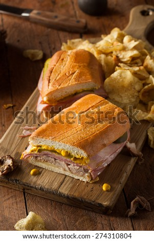 Homemade Traditional Cuban Sandwiches with Ham Pork and Cheese - stock photo
