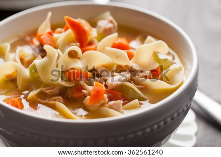 Homemade Turkey Noodle Soup close-up shot - stock photo