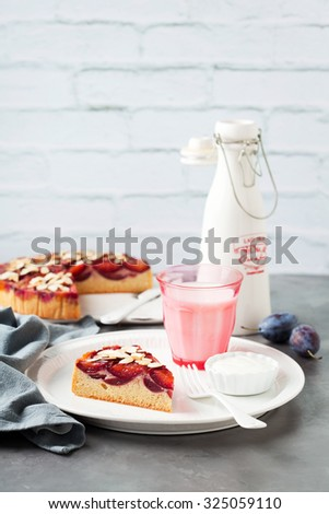 Homemade upside down plum cake of rye flour, selective focus - stock photo