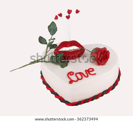 Homemade Valentine heart cake with a mouth and rose isolated on white - stock photo
