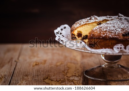 Homemade vanilla cake with raisins. Selective focus. Copyspace for your text. - stock photo