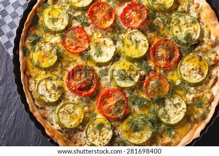 homemade vegetable tart with cheese, tomatoes and zucchini macro. horizontal view from above  - stock photo