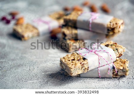 Homemade vegetarian granola bars with almonds on rustic grey background with copy space  - stock photo