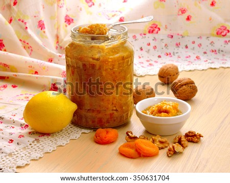 Homemade vitamin jam with honey, nuts, dried apricots and a lemon.
