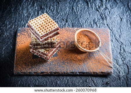 Homemade wafers with nuts and chocolate on stone plate