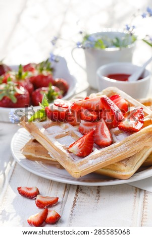 Homemade waffles with fresh strawberries. Delicious breakfast