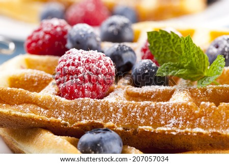 Homemade waffles with fruit and / or whipped cream - stock photo