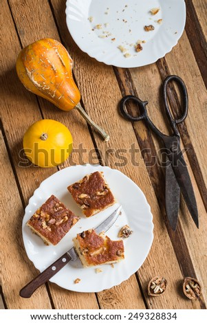 Homemade Walnut Cake and Vivid Color Pumpkins - stock photo
