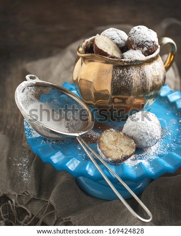 Homemade white chocolate cake pops in a vintage jug.  - stock photo