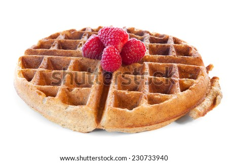 Homemade whole grain waffle with raspberries on white - stock photo