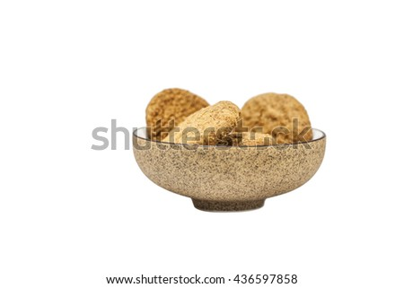 homemade whole meal cereal cookies made from whole wheat flour, vegetable oil, rice flour, corn flour,  rye flour and  fructo-oligosaccharides in a  brown china bowl - stock photo
