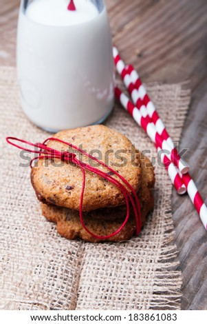 Homemade wholegrain cookies  and milk on the wooden background close-up