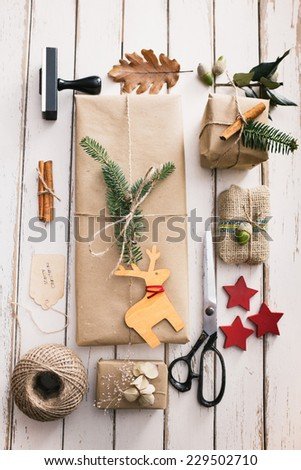 Homemade wrapped christmas presents with nature elements