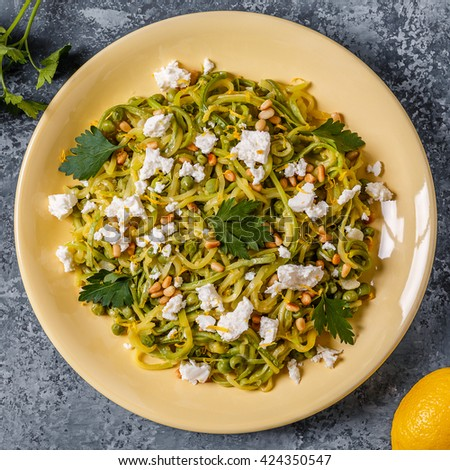 Homemade Zucchini  Zoodles Pasta with Pine nuts and Feta, top view.
