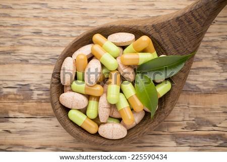 Homeopathic supplement. Alternative Medicine. Vitamin capsules. - stock photo
