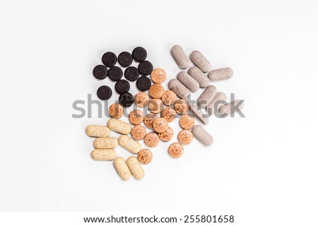 Homeopathic supplement. Alternative Medicine. Vitamin capsules . - stock photo