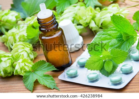 Homeopathy, globules and herbs - stock photo
