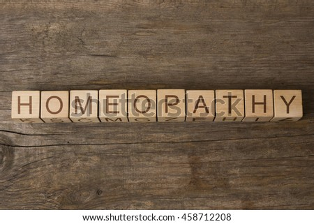 homeopathy text on wooden cubes