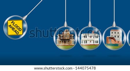 Homes about to be hit by a flood concept - stock photo