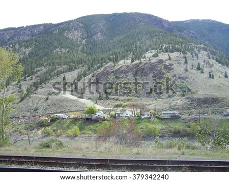 Homes along the river and tracks - stock photo