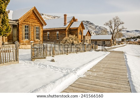 Homes and a church on the main street of Bannack State Park in Montana on a winter day