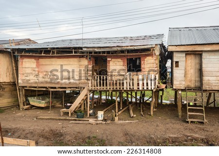 Homes at Amazon river shore, in Nauta, Loreto, Peru - stock photo