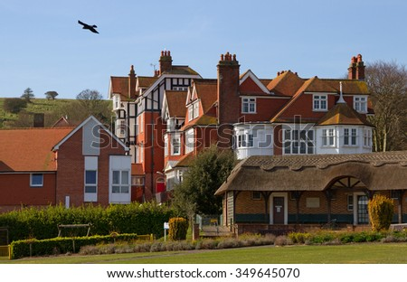 Homes in the Eastbourne with chimneys next to the English channel.
