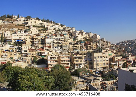 Homes on a hillside in Israel as seen from near the old city of Jerusalem. - stock photo