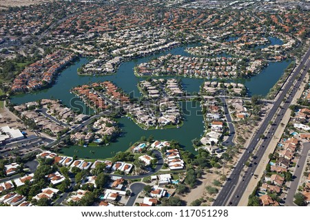 Homes on man made lake in suburban Scottsdale, Arizona - stock photo
